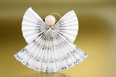The angel made of music paper is one of the simplest, but most creative ideas for … - Diy Christmas Gifts Christmas Love, Diy Christmas Ornaments, Diy Christmas Gifts, Winter Christmas, Christmas Decorations, Hobbies And Crafts, Diy And Crafts, Natal Diy, Paper Angel