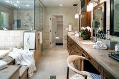 Luxe Loo The master suite's spa-like bathroom features a spacious vanity and a massive glass shower.
