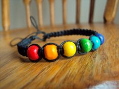 Rainbow Bracelet Wooden Beads Gay Pride Jewelry by JackZenHemp, $8.00 #gaypride #pridejewelry #rainbowbracelet