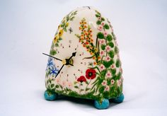 Ceramic clock by Stacey Manser-Knight - - -  http://www.muddypumpkin.co.uk/