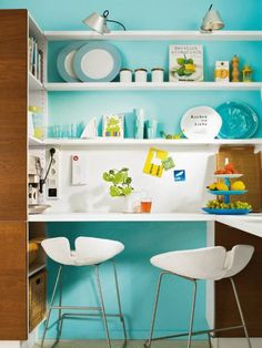 Shelves, shelves, shelves solve the problem of storage in a small kitchen.