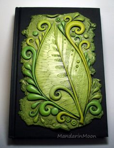 I decorated a blank journal with a plaque I made from polymer clay in various shades of green. It is finally getting warm here. Spring has sprung! I own the copyright to this image. It may not be u...