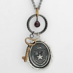 Eternal Happiness Talisman Charm Necklace: This handcrafted talisman necklace reads Contentment Est Assez in French, meaning Happiness is Enough. The star on the shield represents celestial goodness; the stag is a symbol of peace and harmony. The stone on this charm necklace is garnet which has a calming influence, allowing one's inner spirit to radiate.