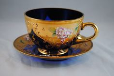 Vintage Bohemian cobalt blue with gilt and raised enamel cup and saucer set