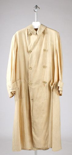 This is a duster coat from 1910. The duster coat in tan would show the effects of dirt that was kicked up on an automobile less than if the coat was in a different color.