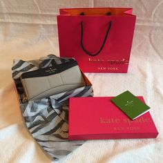 Kate Spade Bow Wallet Mint condition!! I used this wallet for less than a week. It was my first time using an actual wallet like this, but I figured that it was too big for me. I prefer small wallets!! ;) Comes with bag, care booklet and box. NO TRADES AT THIS TIME!! kate spade Bags Wallets