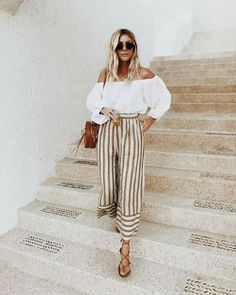 Pretty off the shoulder top with cute striped pants.