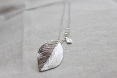 Hey, I found this really awesome Etsy listing at https://www.etsy.com/listing/71104952/modern-leaf-necklace-s2035-1