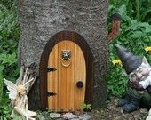 Fairy Doors. I think these would be so cool to put on the trees in the yard.