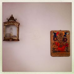 Vintage lamp and painting on bedroom wall