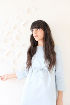 The French blogger Alix from the blog The cherry Blossom Girl wearing a Tara Jarmon blue bow dress. #tarajarmon #bluedress