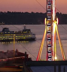 Seattle's Great Wheel lights up a rosy-hued night. Care for a spin?