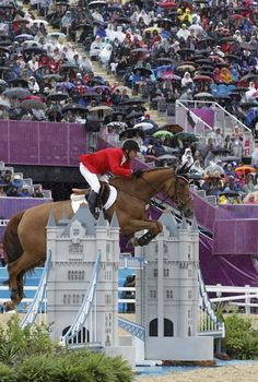 Canada's Eric Lamaze rides Derly Chin De Muze during the equestrian individual jumping second qualifier at the London 2012 Olympic Games