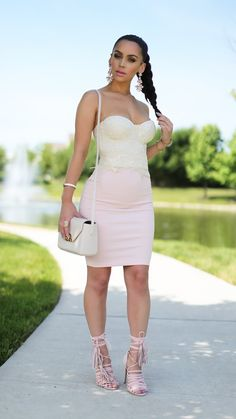 Crochet strapless shirt, light pink pencil skirt paired with pink tassel heels.. absolutely love all her styles by Carli