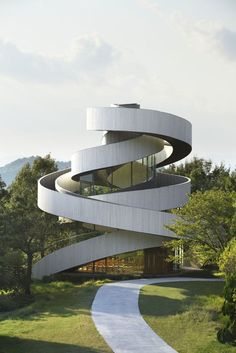 """Spiraling Japanese ribbon chapel """"uses love as a metaphor."""" ...? It's a concrete ribbon staircase cake. Do you get married at the top? http://www.slate.com/blogs/the_eye/2015/02/12/ribbon_chapel_by_hiroshi_nakamura_is_the_most_romantic_wedding_chapel_in.html?wpsrc=fol_tw"""