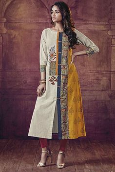 Make a style statement wearing this gorgeous cream & yellow designer kurti featuring blue detailing along with a front slit while a patch of floral resham embroidery decorates one side and wooden show buttons finish the look! Salwar Designs, Kurta Designs Women, Kurti Designs Party Wear, Printed Kurti Designs, Dress Neck Designs, Blouse Designs, Kurta Patterns, Pakistani Dresses Casual, Kurta Neck Design