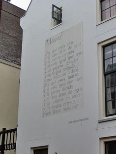 The poem Misterio of the Peruvian author Jorge Eielson on the back wall of the building at Noordeinde 6 in Leiden, The Netherlands