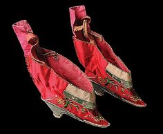 A pair of Chinese silk embroidered ladies bound feet shoes late Qing Dynasty.