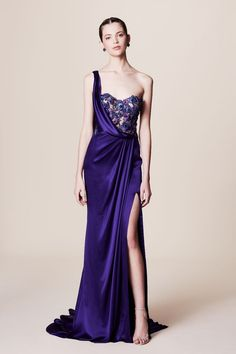 Featured Dress: Marchesa; Sleek royal purple one-shoulder wedding dress with thigh high slit