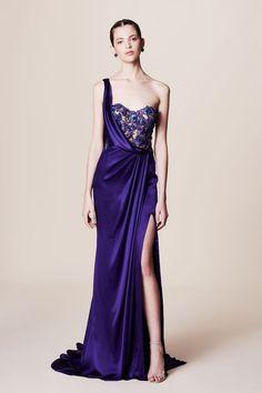 Featured Dress: Marchesa; Sleek royal purple one-shoulder wedding dress with thigh high slit