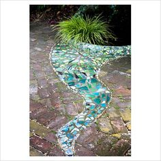 Mosaic Tiles within Brick Walkway. I was going to do this with old broken dishes !