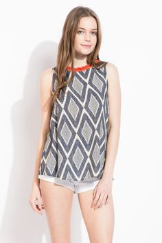 Adore the abstract diamond print with the red fringe detail! Great bohemian piece that can be dressed up or down.
