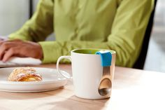 """Check out the MugStir from Quirky.com $10.99 Food-safe stainless steel spoon, with a silicone-coated handle. - Handle clips to the side of your mug, so it stays in place when you raise your mug for a drink. - Comes in packs of three spoons: purple, pink, and blue. Dimensions: Measures 3.5"""" long, the ideal size for most standard mugs."""