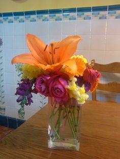 Y con tus flores en un jarrón