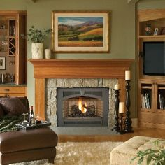 "The mantle does a beautiful job of framing the texture of this fireplace surround. The black trim makes the fire ""pop""."