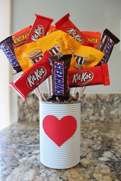Candy boquet - I love this idea because it can work for all kinds of holiday besides just V-day. Using the snack size candies is a great idea too - less calories and still a nice treat.