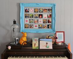 DIY photo frame out of vintage frame (could easily find cheap frame at Goodwill/garage sales) and wire hanging across and hold pictures with clothespin.