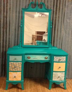 Vanity with paper covered drawers. Painted by A to Z Custom Creations with Websters Chalk Paint Powder and Benjamin Moore's Aruba.