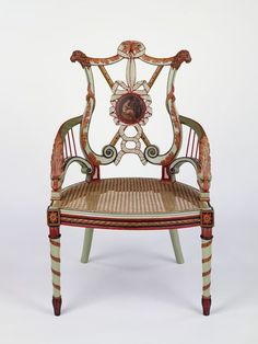 """1780-1785 British Armchair at the Victoria and Albert Museum, London - From the curators' comments: """"This chair (with its pair, W.18-1931) is part of a larger suite that formerly furnished the Music Room at Woodhall Park, Hertfordshire....This chair is a rare example of 18th-century furniture retaining its original paint. Painted decoration was highly fashionable in the 1770s-80s, and the mixture of colours used here was intended to evoke the colouring of ancient Greek, or 'Etruscan' vases."""""""