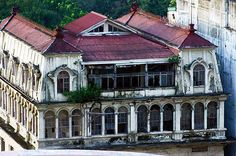 """""""Abandoned Luneta Hotel - Manila, Philippines"""" -- [Completed in 1918, the Luneta Hotel is said to be designed by Spanish architect-engineer Salvador Farre. It is one of the few remaining structures that survived World War II.  The Luneta Hotel was declared as a National Historical Landmark under  Presidential Decree 1505.]~[Photograph by laz'andre (laz'andre cawagas) - May 3 2006 - Manila, National Capital Region, Philippines]'h4d-69.2013'"""