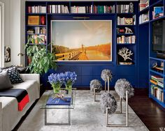 At a New York City penthouse decorated by Nicholas Kilner, a Ryan McGinley photograph dominates the guest room, where the furnishings include 1970s Nanda Vigo chairs and a Madeline Weinrib carpet.
