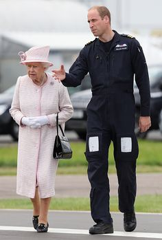 Prince William, Duke of Cambridge gives Queen Elizabeth II a tour as they open the new East Anglian Air Ambulance Base at Cambridge Airport on July 13, 2016 in Cambridge, England.