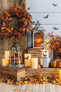 Fill lanterns with pumpkins and other fall pieces for an easy DIY-decor idea. #Fall Porches