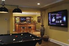 Basement - love the flat screen by the pool table idea - not the wall color!