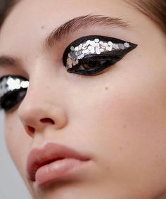 silver sequins over black - draamtic, graphic eye makeup