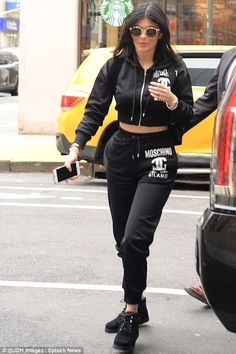 Kylie Jenner wearing Dior Cd Reflected Sunglasses, Vianel Lizard Iphone Case…
