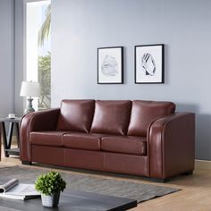 Modernize your living room with this comfy sofa. This sofa features firm seats with pocket coil cushions and piping design. The rich brown finish allows for a sleek modern feel.