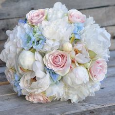 Bridal bouquet and boutonniere shipping out for a destination wedding in Paris. Holly's Flower Shoppe on Etsy. Silk wedding flowers shipping worldwide!