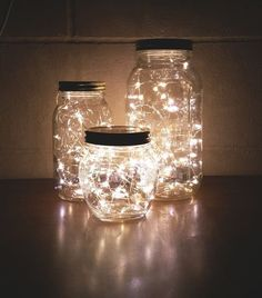 Learn how to make mason jar luminaries with our quick and easy #DIY tutorial! #howtomakeweddingcandles #christmascandlesjars
