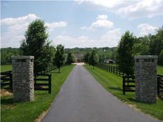 Front and driveway entrance without the stone pillars. Driveway Entrance Landscaping, Driveway Design, Driveway Gate, Country Landscaping, Acreage Landscaping, Fence, Asphalt Driveway, Farm Entrance, Entrance Ways