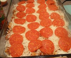 WW Pizza Pasta Casserole  Points Plus: 6  1 lb ground lean turkey sausage  1 medium onion , chopped  1 clove garlic , minced  1 teaspoon italian seasoning  2 teaspoons olive oil  1 (26 ounce) jars spaghetti sauce  8 ounces rotini pasta , cooked and drained  2 cups shredded reduced fat mozzarella cheese (20 oz)  32 slices of turkey pepperoni