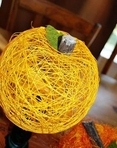 Adorable DIY pumpkins made from twine - these would be so cute in a smaller size for place cards at your holiday table
