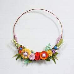 A beautiful mixture of lovely handmade felt flowers for your front door! YOU will LOVE this beautiful wreath and so will your neighbors. {