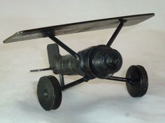 Funky Spark Plug Folk Art Toy Airplane, Spirit of St. Louis Look-A-Like, $14.00    Gift for Nick?