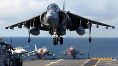 A Harrier of 1 Squadron RAF took part in Deck Operations on-board HMS Illustrious. Here a Harrier is shown landing on the flight deck, with some Sea Harrier in the background. × — More Military pics here Military Jets, Military Aircraft, Air Fighter, Fighter Jets, Hms Illustrious, Jas 39 Gripen, Flight Deck, Royal Air Force, Fighter Aircraft