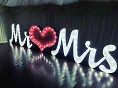 Light up Mr & Mrs letters set joined writing style with cabochone fairground bulbs - 3ft tall  Light Up Letters Inspiration - https://www.lightuplettersbali.com/